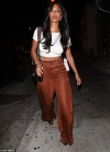 Nicole Scherzinger, 41, displays her tanned and toned stomach in a crop top as she parties up