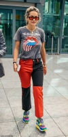 Rita Ora cuts a casual ensemble in a Rolling Stones T-shirt and split colour