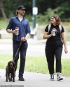 Tom Hiddleston steps out with female friend as he takes his dog for a stroll