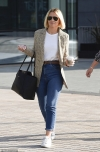 Kimberley Walsh cuts a stylish figure in a checked blazer and jeans