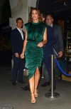 Cindy Crawford, 53, looks incredible in green satin midi dress as she leaves