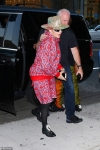 Madonna, 61, displays her kooky style in cropped joggers with black tights