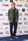Ed Sheeran donates 18 pairs of his old slippers to a charity shop...