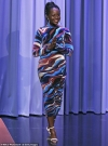 Lupita Nyong'o cuts a chic figure in abstract-patterned dress as she appears on the Tonight Show
