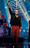 Robbie Williams' festive album The Christmas Present looks set to top the UK charts...