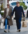 James Corden holds hands with wife Julia as they run errands in LA...