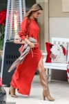 Alessandra Ambrosio stuns in scarlet as she steps out for a family Christmas dinner