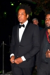 Jay-Z looks dapper in classic black tuxedo as he attends Grammys afterparty without his wife Beyonce