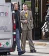 Rocco Ritchie emulates dad Guy's style as he steps out wearing a retro suit in London...