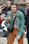 Harry Styles rocks another black leather Gucci bag as he greets fans following BBC R2 appearance...