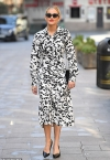 Ashley Roberts looks typically chic in a speckled shirt dress as she continues