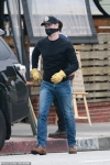 Colin Hanks dons a mask as he picks up food in LA after his dad Tom Hanks