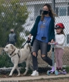 Olivia Wilde dons face mask to walk dog in LA with daughter Daisy, 3