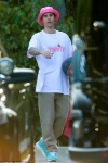 Justin Bieber reps his own music by donning Yummy shirt with pink bucket