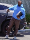 Kanye West dons his new Yeezy Foam Runners and a bright blue hoodie