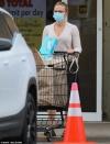 Scarlett Johansson stays warm in a beige sweater as she picks up