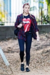 Amber Heard shows off fall fashion in red flannel and a Rolling Stones