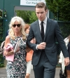 Will Poulter looks dapper in green suit as he treats his mother to a day
