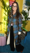 Demi Moore looks every inch the fashionista in quirky checked coat and funky glasses