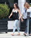 Pregnant Mila Kunis looks radiant with minimal make-up as she covers