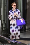 Celine Dion brightens up Paris in a colourful coat and matching handbag