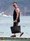 David Furnish cuts a youthful figure in shorts and vest top