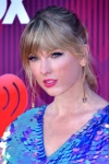 Taylor Swift admits to cutting her own hair in lockdown...