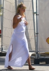 Kate Hudson shows off her golden glow in low-cut white maxi with sexy