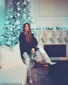 Khloe Kardashian works glamorous thigh-high boots as she celebrates