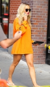 Rita Ora puts on a leggy display wearing nothing but a vibrant oversized jumper