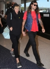 Kesha keeps a low-profile in a hoodie as she departs LAX with boyfriend Brad Ashenfelter