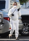 Pregnant Ashley Tisdale looks ultra cozy in an ivory hoodie and sweatpants while taking