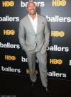 Dwayne Johnson tops list of world's highest-paid actors after taking home $64m last year...