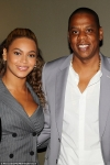 Beyonce shows some cleavage in plunging suit as she joins husband Jay Z for pal Usher's