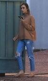 Lily Collins looks simply stylish in brown sweater and distressed blue jeans in Beverly Hills...