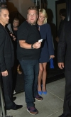 James Corden opts for a casual look while his wife Julia Carey cuts a leggy figure
