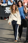 Sarah Jessica Parker opts for comfortable style in striped trousers and billowy blouse