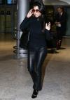 Kourtney Kardashian looks incredibly glamorous in sleek leather flares