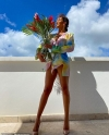 Love Island's Montana Brown puts on a VERY leggy display in a colourful shirt dress and heels as she celebrates