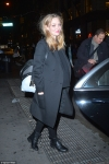 Pregnant Amanda Seyfried shows off her growing baby bump in a casual jumper