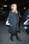 Pregnant Amanda Seyfried shows off her burgeoning baby bump in a cosy black