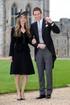 Eddie Redmayne beams with pride beside wife Hannah as he's made an OBE