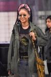 Rihanna cuts a casual figure in military chic ensemble and dreadlocks