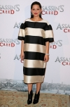 Pregnant Marion Cotillard slips her blossoming bump into chic striped shift dress