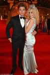 Newly-engaged Pixie Lott looks royally good in a huge tiara and silk gown as she attends BFAs