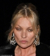 Bleary-eyed Kate Moss puffs on suspicious-looking cigarette in private jet's cockpit...