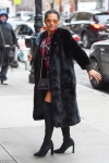 Mel B puts on a leggy display in sexy thigh-high boots and a lavish fur coat as she steps