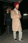 Solemn Matthew McConaughey looks tired and sports unkempt beard as he heads