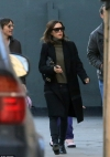 Victoria Beckham cuts a low profile in shades and a black
