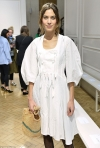 Fashionista Alexa Chung covers up in a demure peasant-style dress teamed